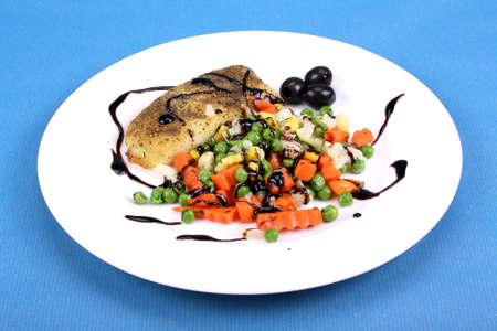 Hake with buttered vegetables and balsamic cream photo