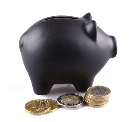 Black piggy bank with euro coins on white background photo