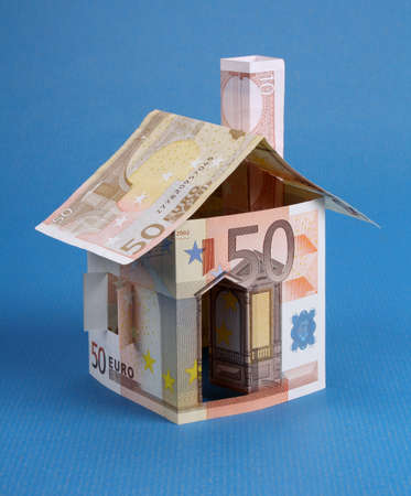 House of fifty euro notes on a blue background photo