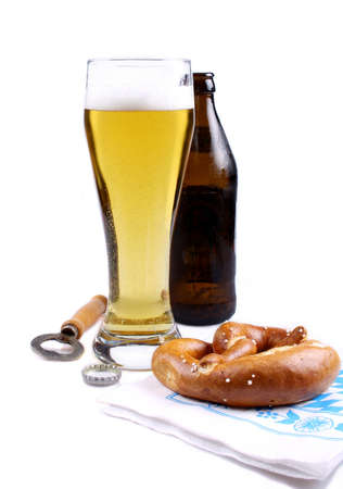 unbottled: Light beer in glass with brown pretzel and bottle opener