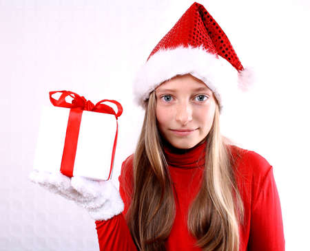 Young girl as Mrs  Santa in red holding a gift photo