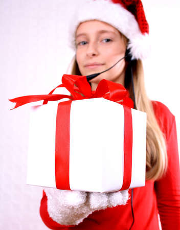 Blond girl as Mrs  Santa with a headset and gift photo