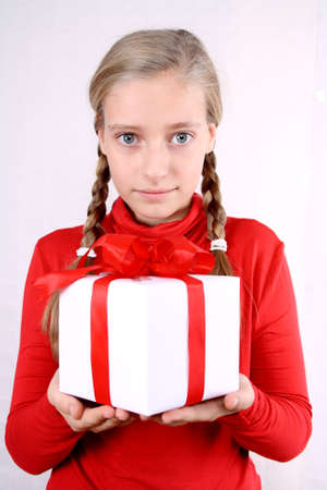Thankful girl in red holding a present photo