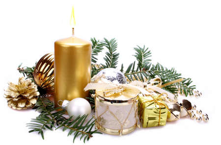 Christmas decoration with candle over white background Stock Photo - 16535861