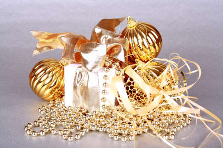 Golden Christmas decoration on silver background closeup Stock Photo - 16535874