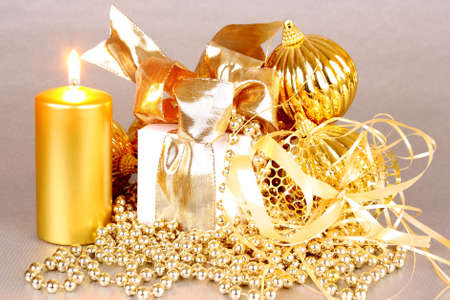 Golden Christmas decoration with candles on silver background Stock Photo - 16535873