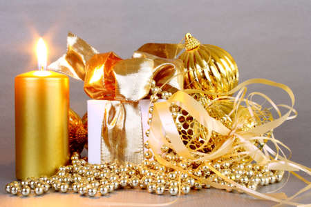 Golden Christmas decoration with candles on silver background photo