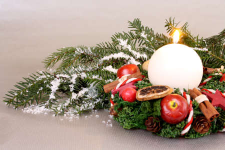 Christmas wreath with candle and Christmas decoration on silver background Stock Photo - 16535868