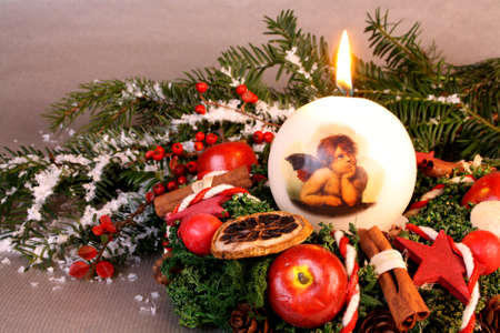 Christmas wreath with candle and angel on a silver background Stock Photo - 16535872