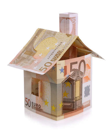Euro house made   from banknotes on white background Imagens