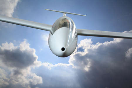 White sailplane flying through frontal rain clouds 스톡 콘텐츠