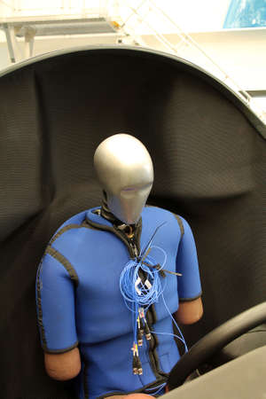 Dummy sits in the chair ready for test