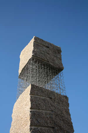 Abstract stone monument on the blue sky Stock Photo - 17164026