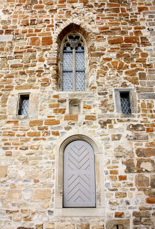 Old church facade of brick with window and door Stock Photo - 17164087