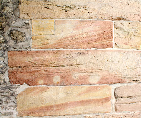 Old wall from a red-yellow rock closeup Stock Photo - 17164083