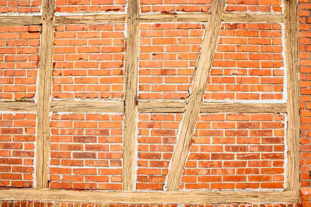 Old red brick wall with wooden beams as background closeup Stock Photo - 17361741