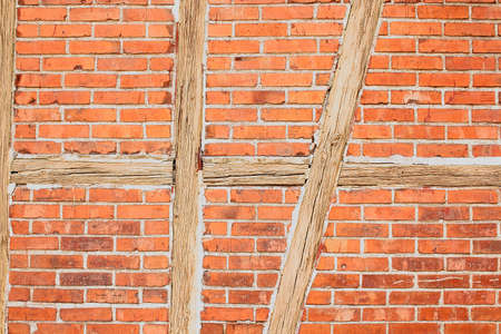 Old red brick wall with wooden beams as background closeup Stock Photo - 17361740