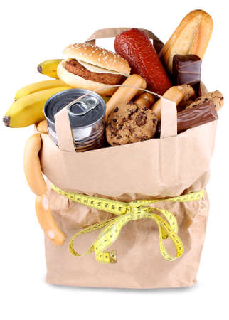 Paper shopping bag with high-calorie foods and measuring tape isolated Stockfoto