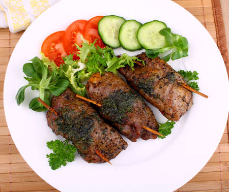 prepared dish: Stuffed Beef pockets with lettuce, tomato and cucumber