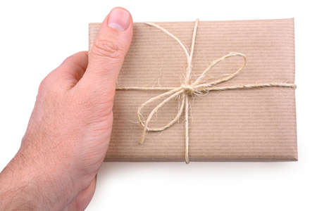 Decorated packet in brown paper in man Stock Photo - 18056626