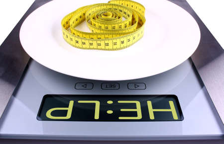 Weight concept  Digital scale with help ad, closeup