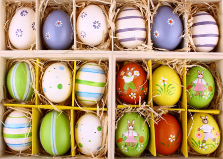 Easter eggs collection in wooden box as background photo