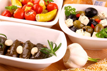 Stuffed vine leaves and Mediterranean antipasti closeup photo