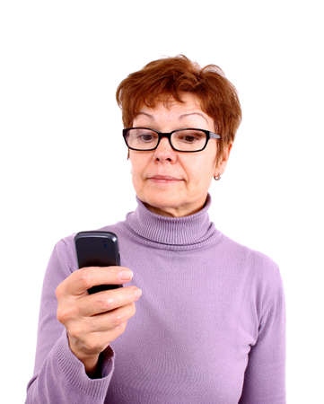 Attractive mature woman with mobile phone, isoliert photo