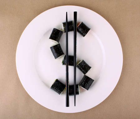 Maki Sushi as dollar sign on white plate, close up photo
