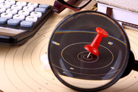 Hit the target with magnifying glass - target with red pin photo