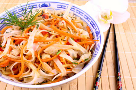 Rice noodle with chicken meat, chopsticks with orchid Stock Photo - 18702606