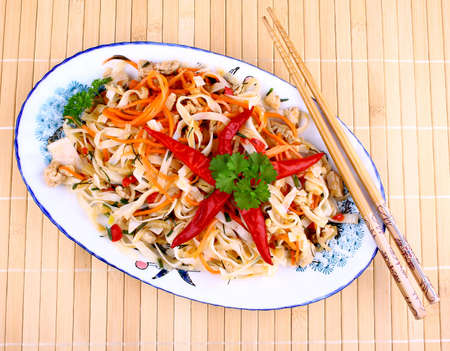 Rice noodle with chicken meat and chili star, top view photo