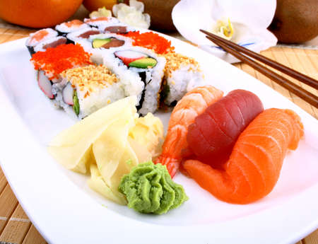 Appetizing sushi with wasabi and chopsticks closeup Imagens