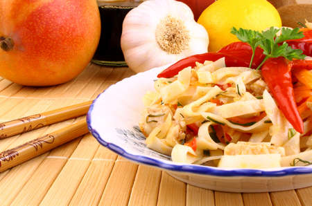 Rice noodle and hot chili pepper with fruits in the background Stock Photo - 18780464