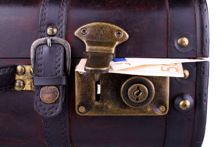 Old suitcase with fifty euro, close up photo