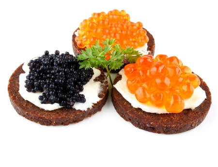 pumpernickel: Pumpernickel bread with red and black caviar, close up Stock Photo