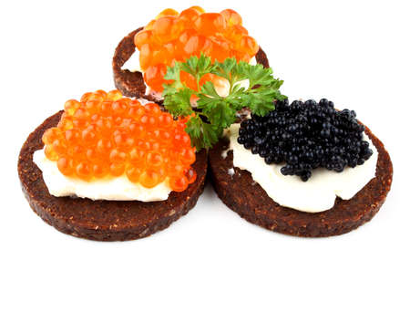 sturgeon: Black bread with salmon, trout and sturgeon caviar, close up Stock Photo