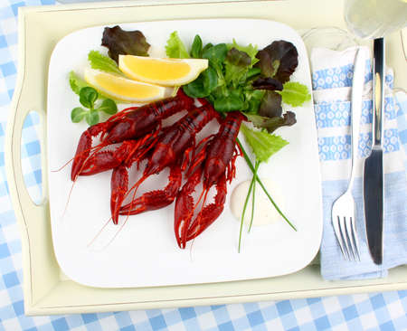 Boiled crayfish with lemon, lettuce and champagne photo