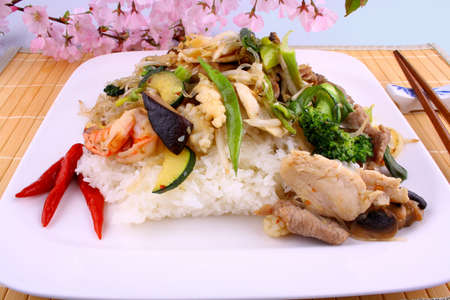 Asian glass noodles, rice, meat, prawn vegetables and cherry blossoms, close up photo