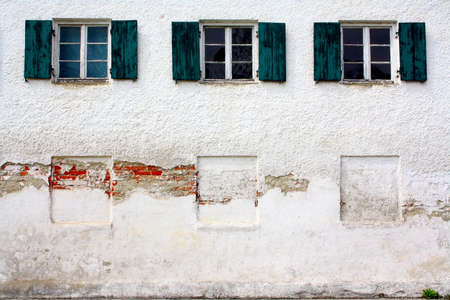 Three old windows on old white wall as background, close up photo