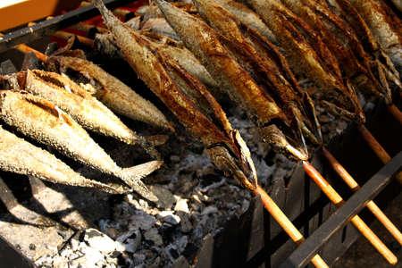 Grilled fish  Steckerlfisch  at the Munich Oktoberfest