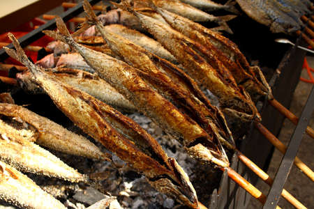 Grilled fish  Steckerlfisch  in Munich Oktoberfest, close up