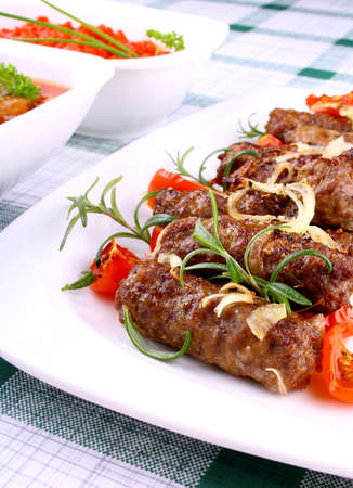 Grilled meat rolls with giant white beans and sauce, close up
