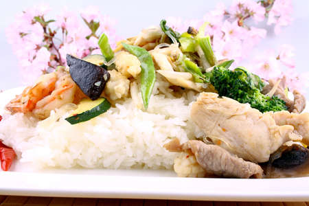 Asian rice with prawn, meat and vegetable, close up photo