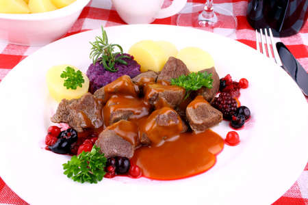 Deer goulash with potato, Burgundy sauce and wild berries, horizontal