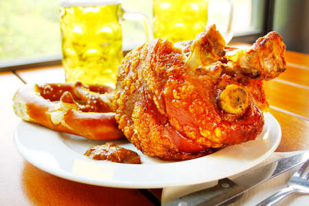 sweet mustard: Grilled pork with sweet mustard, pretzels and beer, hirizontal Stock Photo