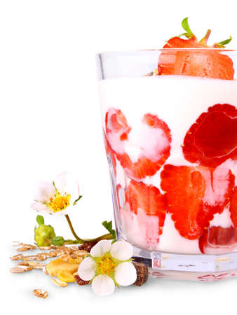 Ripe strawberries with white yogurt in glass, flowers and cereal, isolated photo