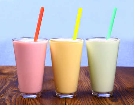 Red, yellow and green soft drink, milk shake, close up Imagens