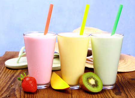 Strawberry, mango and kiwi soft drink, smoothie, and holiday background