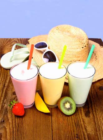 Strawberry, mango and kiwi soft drink with holiday background, close up